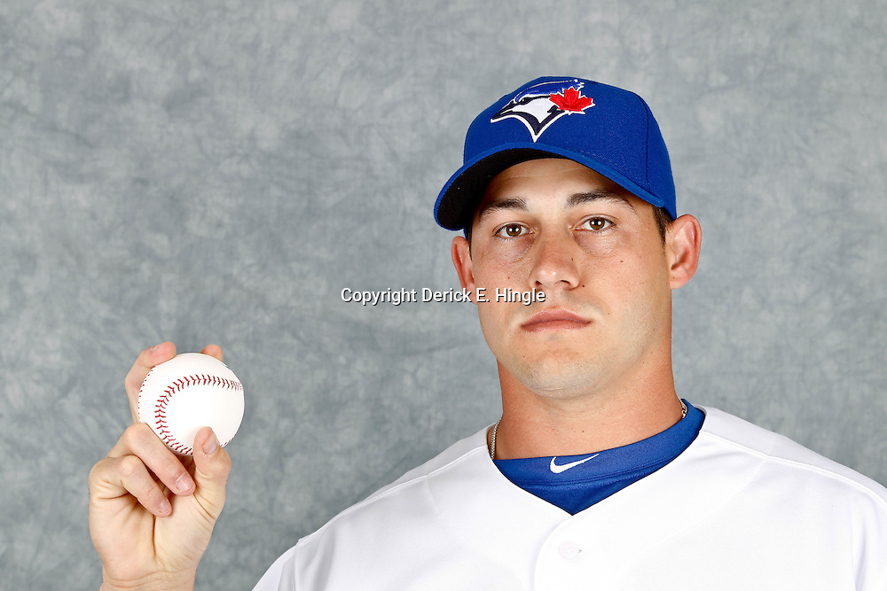 March 2, 2012; Dunedin, FL, USA; Toronto Blue Jays starting pitcher Dustin McGowan (29) poses for a portrait during photo day at Florida Auto Exchange Stadium.  Mandatory Credit: Derick E. Hingle-US PRESSWIRE