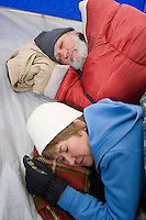 Senior couple sleeping in tent