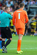 Scunthorpe keeper is shown an early exit during the Sky Bet League 1 match between Burton Albion and Scunthorpe United at the Pirelli Stadium, Burton upon Trent, England on 8 August 2015. Photo by Aaron Lupton.
