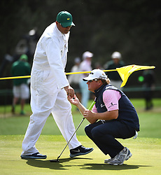 Caddie Brandon Antus returns William McGirt's golf ball to him prior to McGirt putting on the 17th green during first round action of the 2017 Masters Tournament at Augusta National Golf Club on Thursday, April 6, 2017 in Augusta, Ga. McGirt finished the round at -3. (Photo by Jeff Siner/Charlotte Observer/TNS) *** Please Use Credit from Credit Field ***