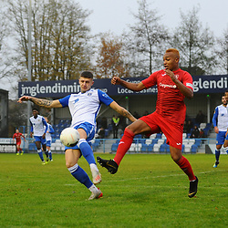 TELFORD COPYRIGHT MIKE SHERIDAN Marcus Dinanga battles with Brad Nicholson during the Buildbase FA Trophy 3Q fixture between Guiseley and AFC Telford United at Nethermoor Park on Saturday, November 23, 2019.<br /> <br /> Picture credit: Mike Sheridan/Ultrapress<br /> <br /> MS201920-031