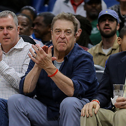 Apr 4, 2018; New Orleans, LA, USA; Actor John Goodman (center) in attendance courtside watching a game between the New Orleans Pelicans and the Memphis Grizzlies during the fourth quarter at the Smoothie King Center. The Pelicans defeated the Grizzlies 123-95. Mandatory Credit: Derick E. Hingle-USA TODAY Sports