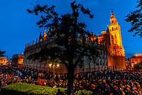The procession of the Brotherhood (Hermandad) El Calvario winds around the Seville Cathedral predawn on Good Friday, Holy Week (Semana Santa), Seville, Andalusia, Spain.