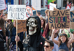 © Licensed to London News Pictures. 08/07/2015. Bristol, UK.  An 'Austerity Kills' anti-cuts protest in Bristol city centre against today's budget by the Government, the first fully Conservative budget for nearly 20 years with cuts to expenditure on welfare and benefits.  The demonstration was one of many in a national day of action organised by The People's Assembly Against Austerity and protesters staged a series of 'die-ins' around Bristol city centre. Photo credit : Simon Chapman/LNP