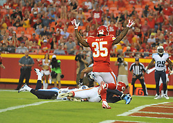 Aug 28, 2015; Kansas City, MO, USA; Kansas City Chiefs tight end Travis Kelce (87) scores a touchdown as running back Charcandrick West (35) celebrates during the first half against the Tennessee Titans at Arrowhead Stadium. Mandatory Credit: Denny Medley-USA TODAY Sports