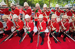 Image ©Licensed to i-Images Picture Agency. 10/06/2014. London, United Kingdom. HRH Prince Harry attends the 50th Anniversary of Zulu premiere. . Picture by Anthony Upton / i-Images<br /> Leicester Square, London, 10 June 2014: The Die Hards re-enactment group on the red carpet at a gala screening to celebrate the 50th Anniversary of Zulu where guests were joined by Prince Harry to watch a digitally remastered version of the iconic film. The evening was arranged to raise money for two charities supported by Prince Harry, Walking With The Wounded and Sentebale. <br /> For further info please contact<br /> Emily Conrad-Pickle Captive Minds<br /> Mobile: +44 (0)7799 414 790<br /> emily.conrad-pickles@captiveminds.com