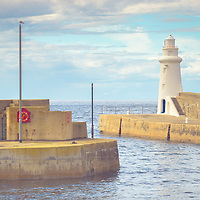 I was passing through the Banff and Buchan area and just had to pull in as I passed the harbour at MacDuff. There was a lovely soft side light hitting the wee lighthouse and just loved the composition.