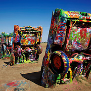 Along Route 66 west of Amarillo, Texas you'll find Cadillac Ranch. It was created by a group of art hippies from San Francisco called The Ant Farm, whose silent partner was an Amarillo billionaire who wanted a piece of public art that would baffle the locals. Their tribute to the evolution of the Cadillac tail fin was ten Caddies half-buried, nose-down, in the dirt. They faced west in a line, from the 1949 Club Sedan to the 1963 Sedan de Ville. That was in 1974. Decades have passed. The Cadillacs have now been in the ground as art longer than they were on the road as cars.