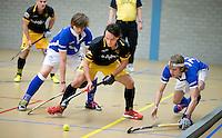 UTRECHT - Hoofdklasse Zaalhockey: Pepijn Luyckx (Den Bosch) aan de bal tijdens de wedstrijd tussen Kampong en Den Bosch. FOTO KOEN SUYK