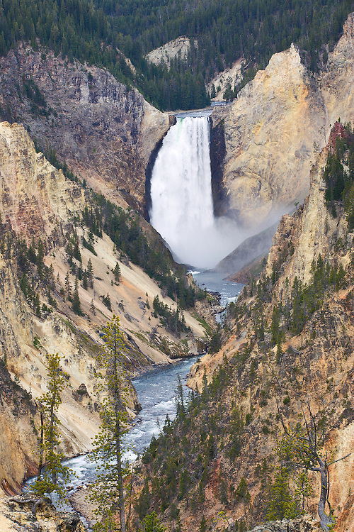 The Lower Falls of Grand Canyon of Yellowstone  is the largest volume waterfall in the Rocky Mountains and the most popular waterfall in Yellowstone National Park. The falls flows through a 590,000 year old Canyon Rhyolite lava flow. The Lower Falls is one of two falls on the Yellowstone River with the Upper Falls being the other fall in the canyon.
