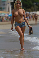 Kelly Van Hoorde Topless Beach Photos