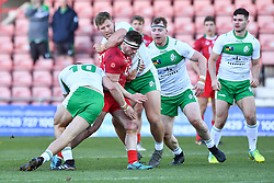 11th November 2018 , Racecourse Ground,  Wrexham, Wales ;  Rugby League World Cup Qualifier,Wales v Ireland ; Connor Davies of Wales is tackled by Liam Byrne of Ireland <br /> <br /> <br /> Credit:   Craig Thomas/Replay Images