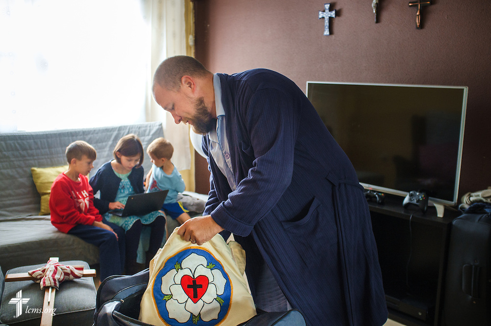 The Rev. Adam Lehman, LCMS career missionary to Spain, packs at home for worship at a nearby makeshift hotel space on Sunday, Nov. 6, 2016, in Seville, Spain.  LCMS Communications/Erik M. Lunsford