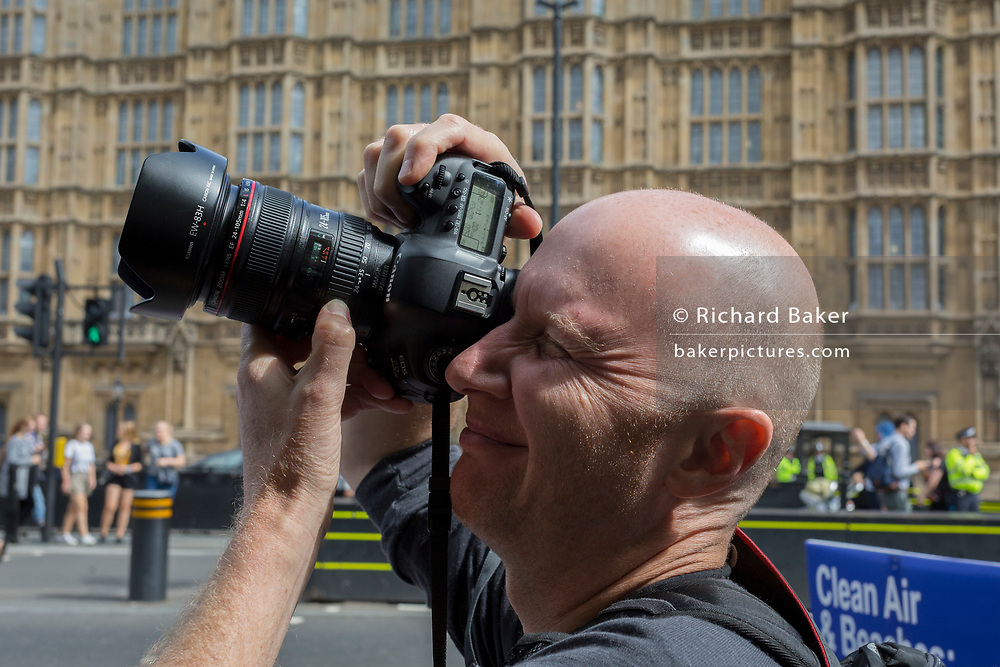 Michael Kemp, photographer, outside Parliament, on 3rd September 2019, in Westminster, London, England.