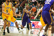Great Danes guard Ray Sanders (1) looks to pass the ball during the men's basketball game between the Albany Great Danes and the Vermont Catamounts at Patrick Gym on Wednesday night January 28, 2015 in Burlington, Vermont. (BRIAN JENKINS, for the Free Press)