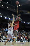 Western Kentucky Hilltoppers forward Dwight Coleby (22) is defended by Southern California Trojans forward Nick Rakocevic (31) in the first half during an NCAA college basketball game in the second round of the NIT tournament in Los Angeles, Monday, Mar 19, 2018. WKU defeated USC 79-75.
