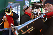 Members of the Mad Bavarian Brass Band entertain the crowd  at the base of the Mittersill double chair lift as Cannon Mountain opens the lift to backcountry skiers; Monday, January 17, 2011. January 1st was the first time a lift has operated on the mountain since Mittersill ski area closed in 1984, but New Hampshire Governor John Lynch and others gathered Monday morning for an official opening and scores rode up to ski and ride the ungroomed and all-natural snow area that has been a favorite of backcountry skiers for more than 25 years.
