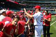 ANAHEIM, CA - AUGUST 24:  Mark Teixeira #25 of the Los Angeles Angels of Anaheim meets with fans to pose for pictures and sign autographs during Photo Day before the game against the Minnesota Twins at Angel Stadium on August 24, 2008 in Anaheim, California. The Angels defeated the Twins 5-3. ©Paul Anthony Spinelli *** Local Caption *** Mark Teixeira