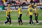 Liam Dawson of Hampshire and team mates celebrate during the NatWest T20 Blast South Group match between Hampshire County Cricket Club and Somerset County Cricket Club at the Ageas Bowl, Southampton, United Kingdom on 29 July 2016. Photo by David Vokes.