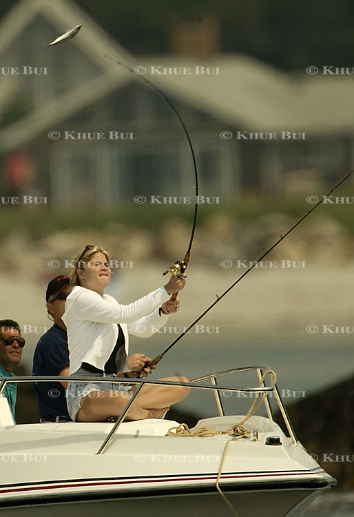 Jenna Bush casts a line during a fishing expedition near the family home Sunday, July 7, 2002, in Kennebunkport, Maine.  President Bush is spending the Independence Day weekend in Kennebunkport, Maine, home of his parents...Photo by Khue Bui