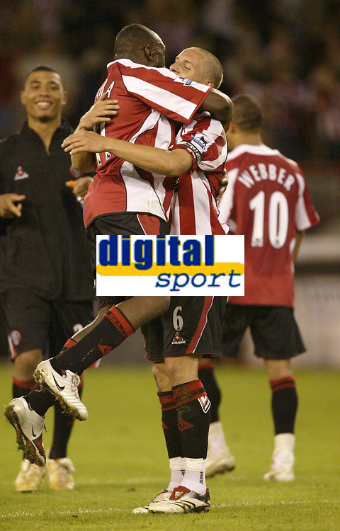 Photo: Aidan Ellis.<br /> Sheffield United v Middlesbrough. The Barclays Premiership. 30/09/2006.<br /> Sheffield's Steve Kabba jumps on match winner Phil jagielka at the end of the game