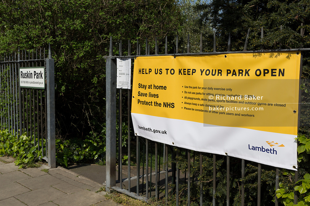 On the first day of the Easter Bank Holiday weekend, and at the end of the second week of lockdown restrictions by the UK government, Lambeth council banners have started appearing outside entrances across the borough, including at Ruskin Park, on 10th April 2020, in London, England.