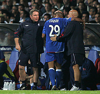 Photo: Paul Thomas.<br />Lyon v Rangers. UEFA Champions League, Group E. 02/10/2007.<br /><br />Goal scorer Daniel Cousins (29) of Rangers is congratulated by assistant manager Ally McCoist (L) and first team coach Kenny McDowall (R) as he comes off half way through the second half.