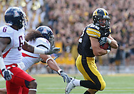 September 19, 2009: Iowa wide receiver Colin Sandeman (22) runs after a reception during the Iowa Hawkeyes' 27-17 win over the Arizona Wildcats at Kinnick Stadium in Iowa City, Iowa on September 19, 2009.