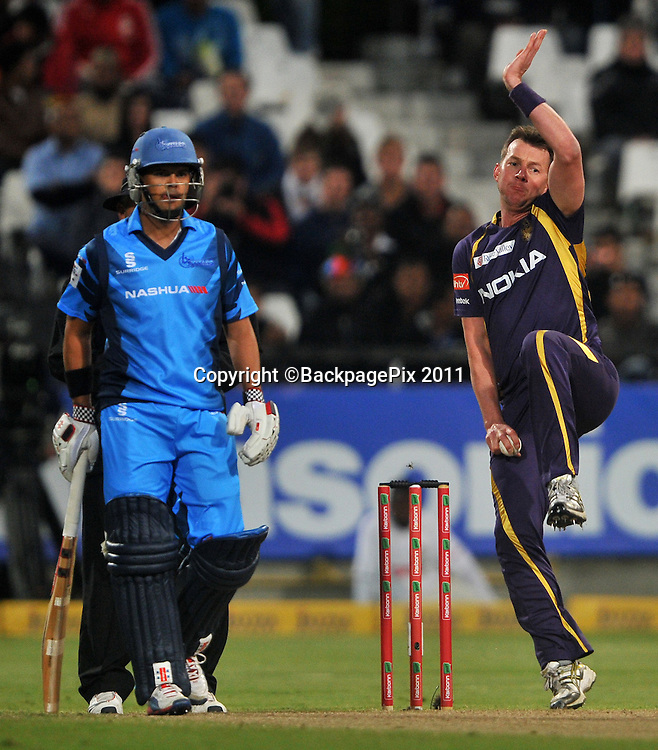 Brett Lee of the Kolkata Knight Riders bowls as Jacques Rudolph of the Titans looks on during the 2012 Champions League Twenty20 cricket match between the Kolkata Knight Riders and the Titans at Newlands in Cape Town on 21 October 2012 ©Ryan Wilkisky/BackpagePix