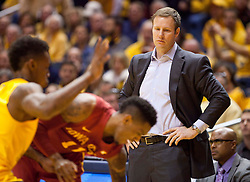 Iowa State Cyclones head coach Fred Hoiberg looks on during a play right in front of him against the West Virginia Mountaineers during the second half at the WVU Coliseum.