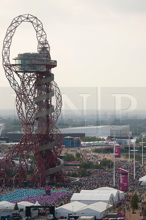 © Licensed to London News Pictures. 12/08/2012. LONDON, UK. Thousands of people are seen next to the ArcelorMittal Orbit in the Olympic Park ahead of the the closing ceremony of the 2012 Summer Olympics is seen in London today (12/08/12). The Games of the 30th Olympiad today come to a close in London after two weeks of athletics and sports competition carried out by 204 countries from around the world. Photo credit: Matt Cetti-Roberts/LNP