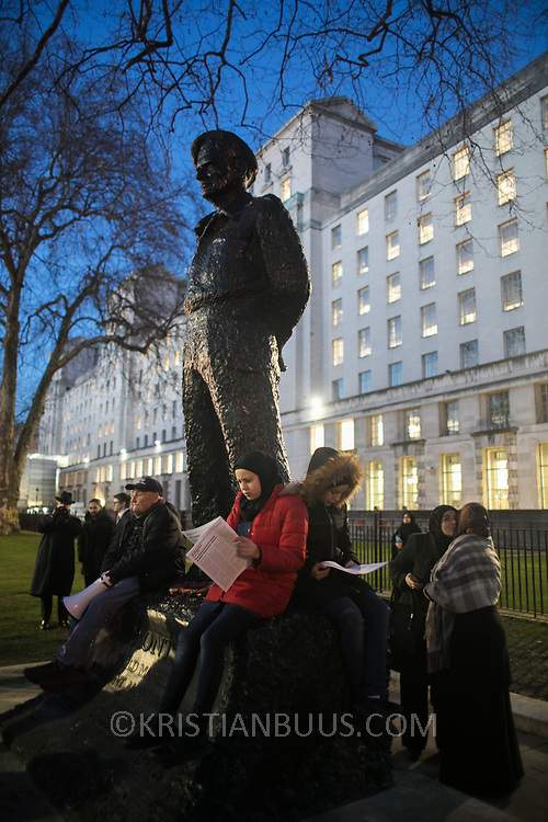 Protesters agains the visit by Saudi prince Bin Salman gather opposite Downing Street March 7th 2018 in London, United Kingdom. Young and old sit around the statue of Statue of the Viscount Montgomery. Many are angry at the Saudi involvement and continued bombing in Yemen with tens of thousands of civilian casualties and many more displaced by the war.
