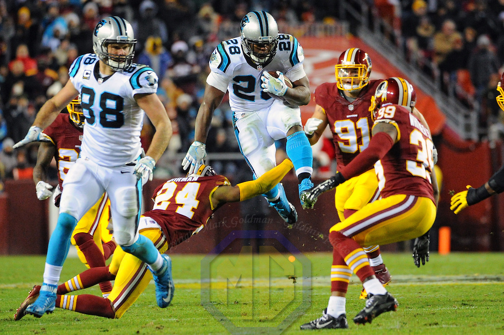 LANDOVER, MD - DECEMBER 19:  Carolina Panthers running back Jonathan Stewart (28) goes up an over Washington Redskins cornerback Josh Norman (24) on a first down fun in the first quarter on December 19, 2016, at FedExField in Landover, MD.    (Photo by Mark Goldman/Icon Sportswire)