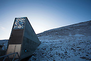 "Nestled into the rocky waste of plataberget Mountain about Svalbard's airport, the Global Seed Vault is at once startling and innocuous. Designed by architect Peter W. Søderman at Barlindhaug Consulting, this concrete, steel and glass structure is the first layer of security to a repository of millions of seeds from around the world, stored here in case of disaster, disease, or war...The Svalbard Global Seed Bank is situated 120 metres (390 ft) inside a sandstone.mountain at Longyearbyen on Spitsbergen Island, in the Svalbard archipelago about 1300km from the North Pole. Svalbard was considered ideal for the bank, due to low tectonic activity and its permafrost, which will aid preservation. Even if sea levels rise due to climate change - and the melting of ice caps, the seeds will be safe and dry , as they are stored at a location 130 metres (430 ft) above sea level. ..The Svalbard Global Seed Vault  provides a safety net against accidental loss of diversity from traditional storage within genebanks around the world, and has a capacity for 4.5 million seeds. Although the media has made much of the ""Doomsday Vault's"" role in providing security in the face of war or or catastrophe, the operators - the Norwegian government  and the Global Crop Diversity Trust and the Nordic Genetic Resource Center - say that it will be most useful when genebanks lose samples due to mismanagement, accident, equipment failures, funding cuts and natural disasters."