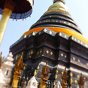 Temple by Nukul. <br /> <br /> Nukul is a 27 years old of a 3 year old baby boy called Nu Nu. Nukul comes from Pong Lam Rang, a Karen village in the mountainous Mae Wang district of northern Thailand. Nukul dreams of traveling to many places on Earth to take beautiful pictures. <br /> <br /> Nukul enjoyed her experience with Lensational as it gave her the opportunity to take a camera back to her village and take photographs of her son. Through the lens she discovered her love for vibrant colors such as cobalt blue, white and black.