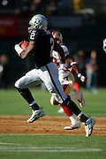 OAKLAND, CA - AUGUST 20:  Quarterback Aaron Brooks #2 of the Oakland Raiders runs the ball against the San Francisco 49ers at McAfee Coliseum on August 20, 2006 in Oakland, California. The Raiders defeated the Niners 23-7. ©Paul Anthony Spinelli *** Local Caption *** Aaron Brooks