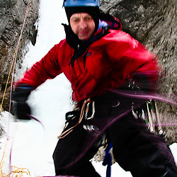 John Rothwell coils the rope after ice climbing Wicked Wanda in the Ghost, Alberta, Canada