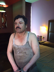 SINALOA, Jan 9, 2016 (Xinhua) -- File photo taken on Jan 8, 2016 shows the drug trafficker Joaquin Guzman Loera, alias ''El Chapo'' Guzman, handcuffed after his arrest in Los Mochis Township, Sinaloa, Mexico. After an early morning raid in northwestern Mexico's Sinaloa State's town of Los Mochis by Mexican police and marines on Friday, Sinaloa Cartel leader Joaquin ''El Chapo'' Guzman Loera was recaptured, six months after his second prison break. In 2001, Guzman was wheeled out by a janitor in a laundry cart. In 2015, Guzman escaped from prison after his allies dug a tunnel about a mile long right into his jail cell at the Altiplano prison in central Mexico. (Xinhua/Str) (jg) (vf) (Credit Image: © Str/Xinhua via ZUMA Wire)