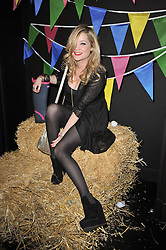 LAURA WHITMORE at a party to celebrate the global launch of the Iconic Brazilian lifestyle brand Havaianas Wellies range held at Selfridges, Oxford Street, London on 14th April 2011.