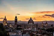 Sunset over the iconic churches in the historic center of San Miguel de Allende, Guanajuato, Mexico. The Parroquia de San Miguel Arcangel, left, San Francisco church, center, and the Immaculate Conception Church also called The Nuns.