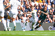 Leeds United defender Ezgjan Alioski (10) and Swansea City forward Andre Ayew (22) in action during the EFL Sky Bet Championship match between Leeds United and Swansea City at Elland Road, Leeds, England on 31 August 2019.
