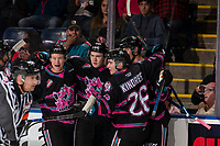 KELOWNA, BC - SEPTEMBER 21: Sean Comrie #3, Kyle Topping #24 and Liam Kindree #26 of the Kelowna Rockets celebrate a first period goal against the Spokane Chiefs Prospera Place on September 21, 2019 in Kelowna, Canada. (Photo by Marissa Baecker/Shoot the Breeze)
