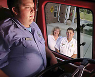 (from left) Firefighter Josh Gaul with parents Retired Paramedic/Firefighter Sharon Gaul and Captain Mark Gaul at Washington Township Fire Station 43, Tuesday August 7, 2007.