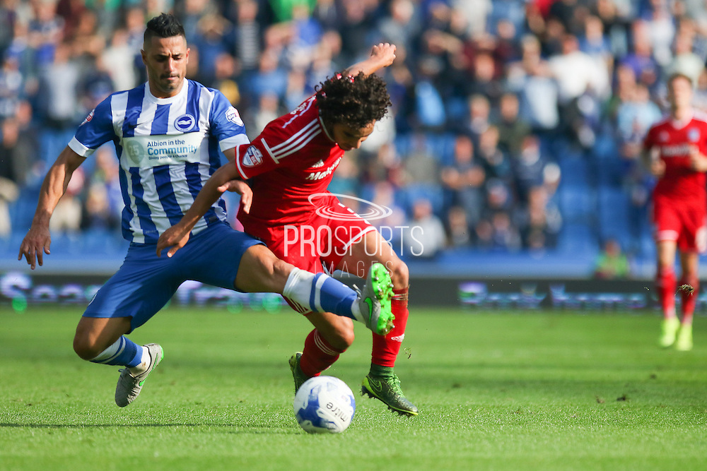 Brighton central midfielder, Beram Kayal with a tackle on Cardiff City defender Fabio Da Silva during the Sky Bet Championship match between Brighton and Hove Albion and Cardiff City at the American Express Community Stadium, Brighton and Hove, England on 3 October 2015. Photo by Phil Duncan.