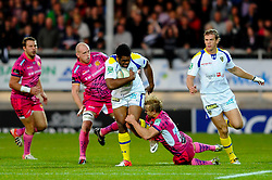 Exeter Chiefs Inside Centre (#12) Jason Shoemark tackles Clermont Winger (#11) Napolioni Nalaga during the first half of the match - Photo mandatory by-line: Rogan Thomson/JMP - Tel: Mobile: 07966 386802 20/10/2012 - SPORT - RUGBY - Sandy Park Stadium - Exeter. Exeter Chiefs v ASM Clermont Auvergne - Heineken Cup Round 2