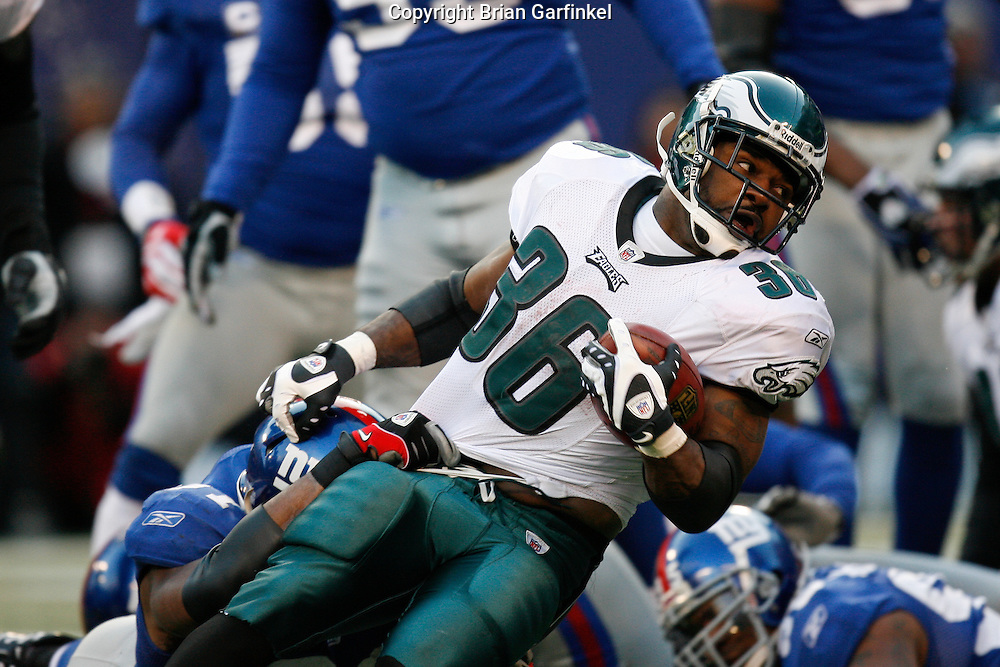 11 Jan 2009: Philadelphia Eagles running back Brian Westbrook #36 is tackled after a carry during the game against the New York Giants on January 11th, 2009.  The  Eagles won 23-11 at Giants Stadium in East Rutherford, New Jersey.