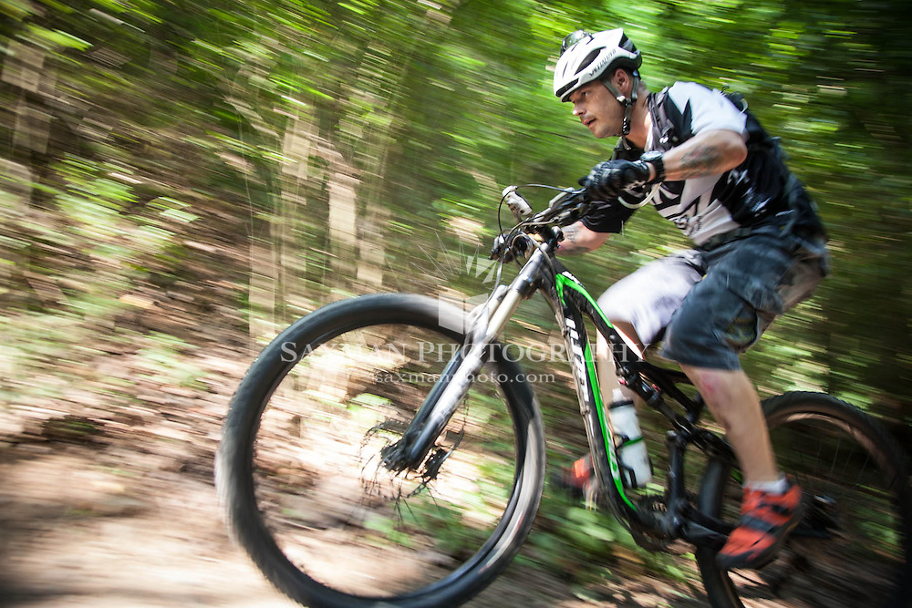 Photos of Dion Miller trail biking on Richmond's Buttermilk Trail