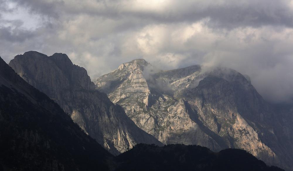 Maja Zat peak, 2400m, Albania. To the right, behind clouds is the Zla Kolata peak (Maja e Keq) 2535m, Albania.