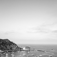 Catalina Island Avalon Harbor black and white photo from above. Includes the Catalina Casino theater, Avalon Pier, and boats. Beautiful Santa Catalina Island is a popular travel destination off the Southern California coast. Photo is high resolution. Copyright ⓒ 2017 Paul Velgos with All Rights Reserved.