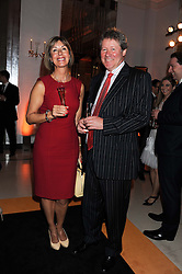 JAMES COCKERAM MD Moet Hennessy Europe and his partner FIONA at the annual Veuve Clicquot Business Woman of the Year Award this year celebrating it's 40th year, held at Claridge's, Brook Street, London on 18th April 2012.